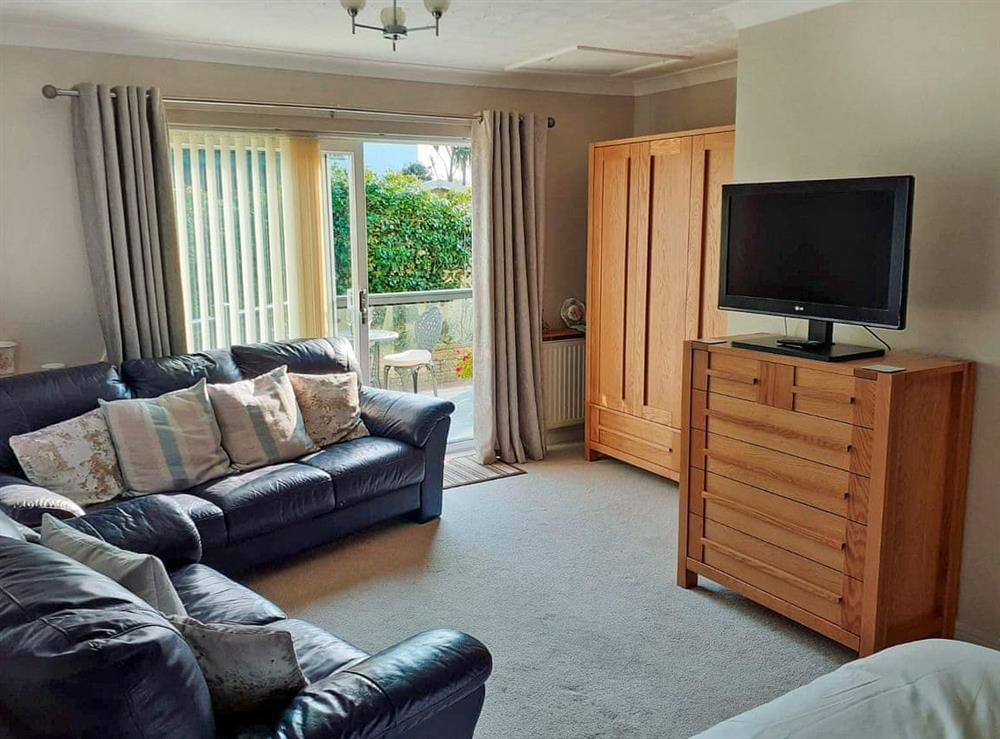 Cosy living room with bedroom area at Green View in Churston Ferrers, near Brixham, Devon