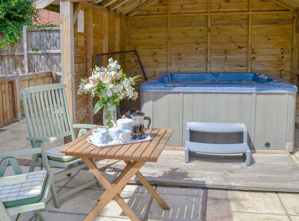 Relaxing hot tub at Greenhaven Lodge in Rackheath, near Wroxham, Norfolk