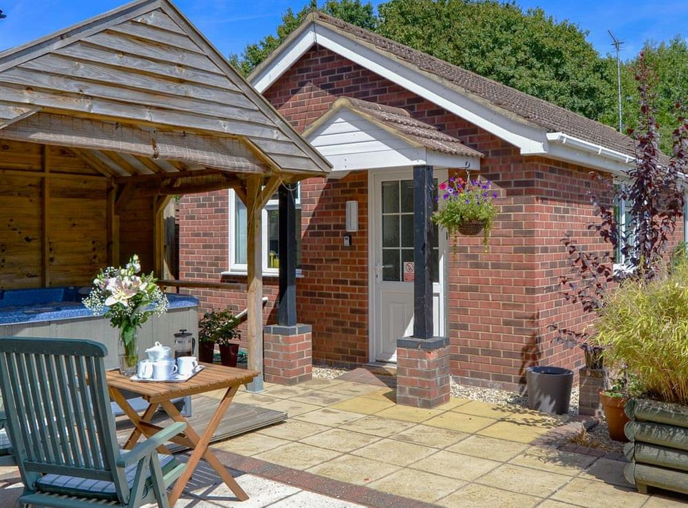 Wonderful holiday home with an enclosed courtyard garden and hot tub at Greenhaven Lodge in Rackheath, near Wroxham, Norfolk