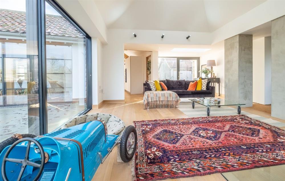 Black Swan Barn ground floor: Open plan sitting room with wood burning stove