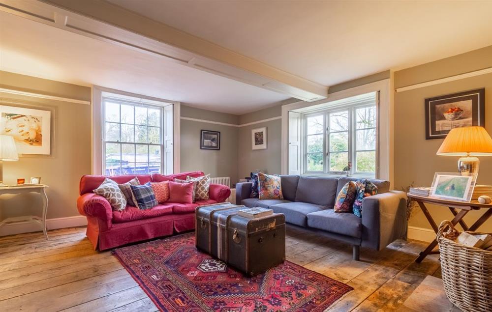 Grove Farm House ground floor: Spacious sitting room with wood burning stove
