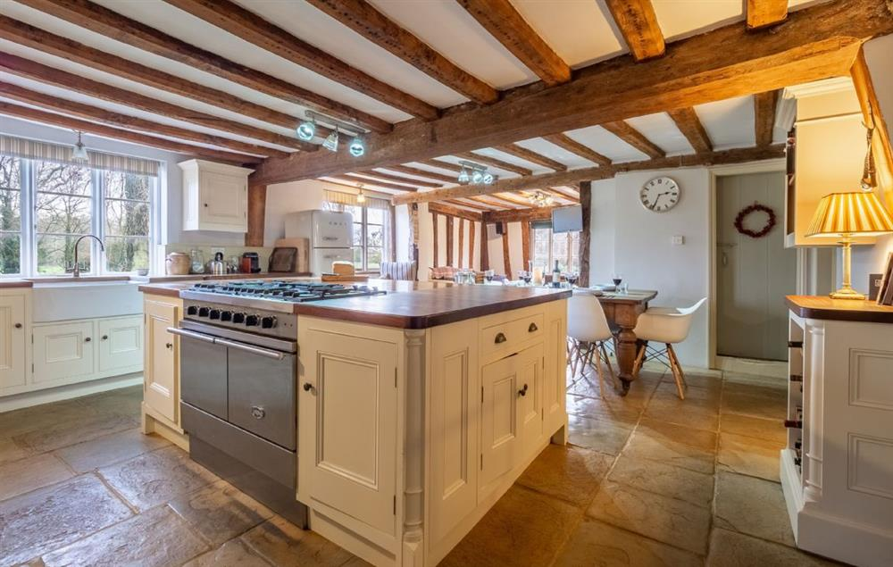 Grove Farm House: Traditional farmhouse kitchen with island and range cooker at Grove Farm, Thornham Magna