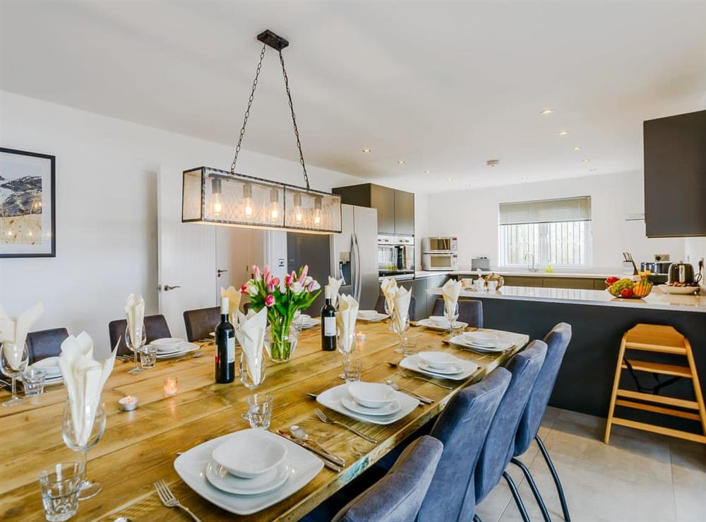 Attractive dining area leading into the kitchen at Meusydd,