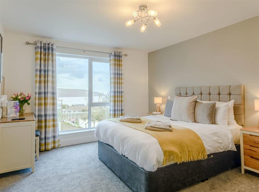 Comfortable double bedroom with coastal views at Meusydd,