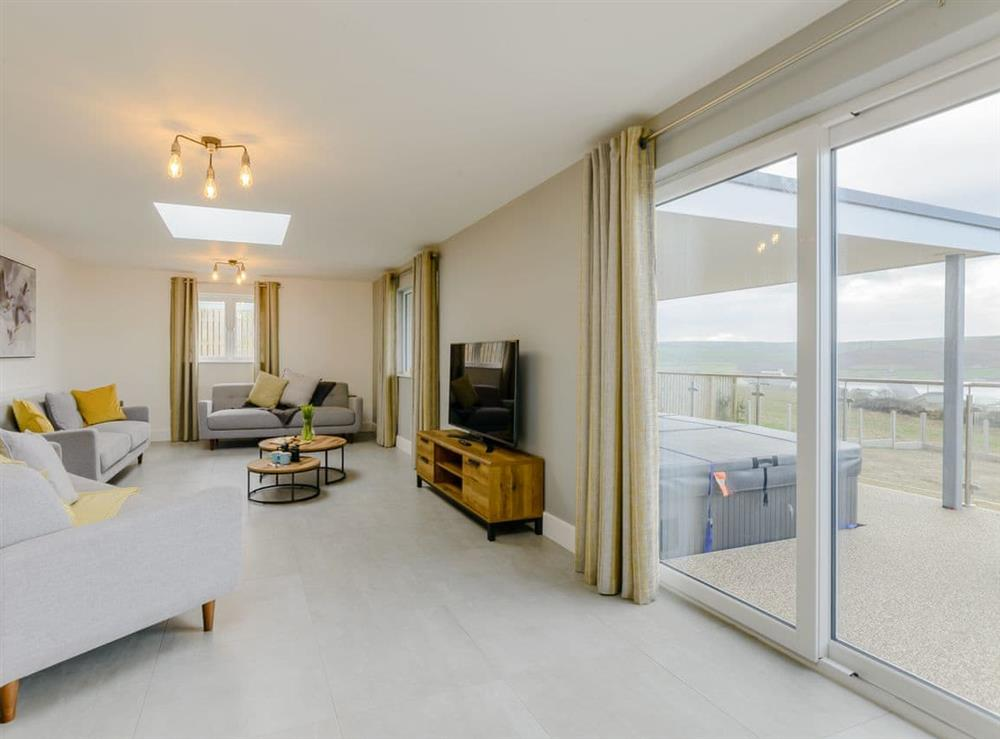 Light and airy living area at Meusydd,