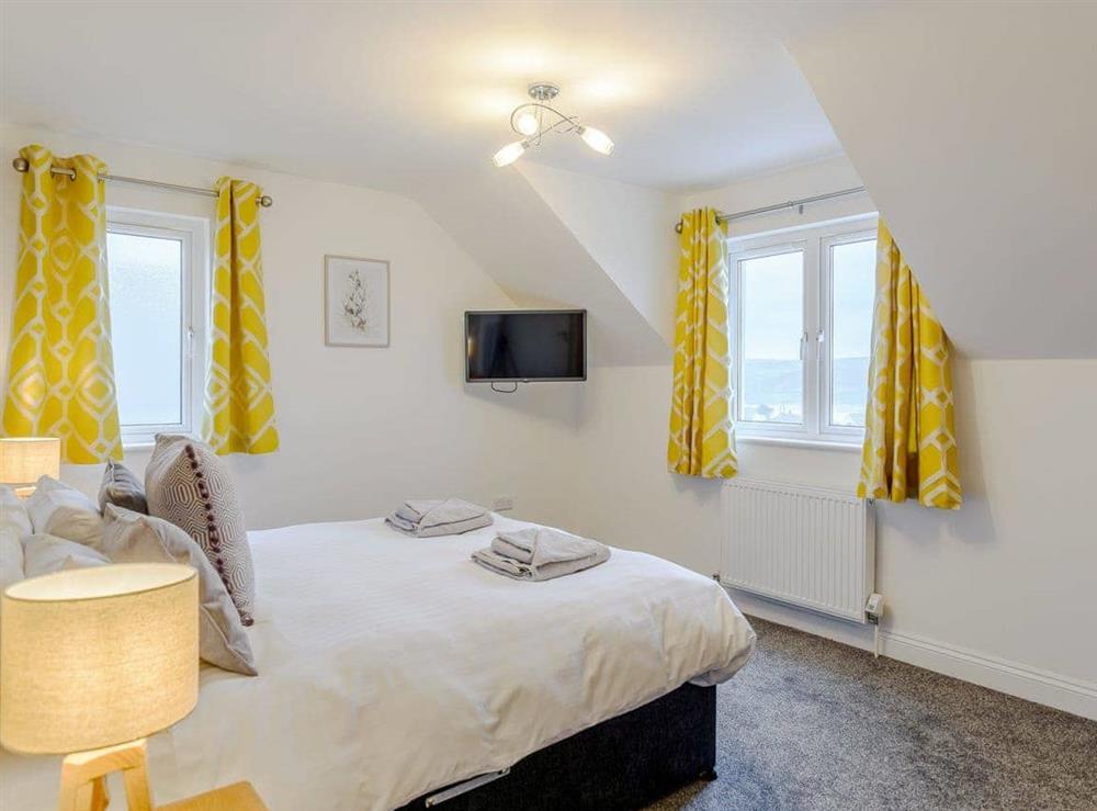 Relaxing double bedroom at Meusydd,