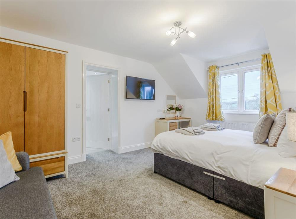 Spacious double bedroom at Meusydd,