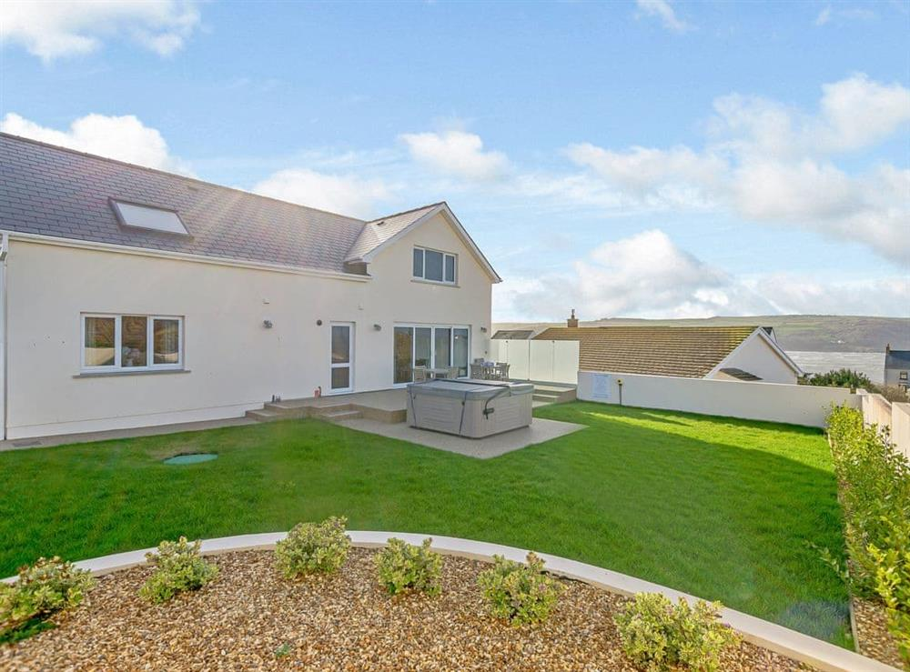 Large garden with seating area and hot tub (photo 2) at Ty Canol,