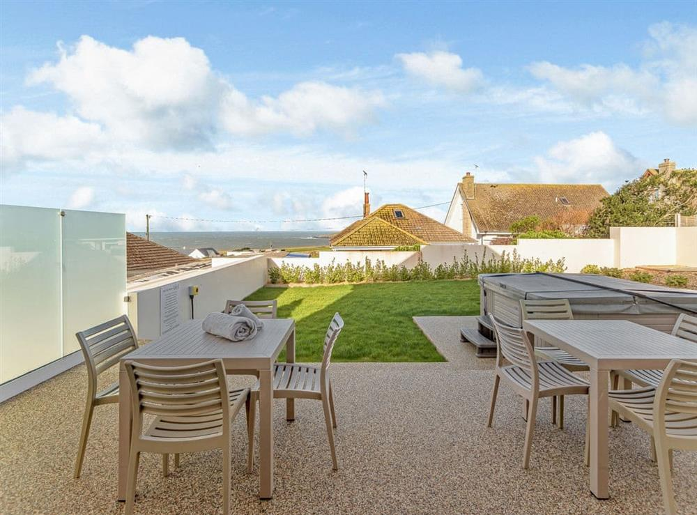 Large garden with seating area and hot tub at Ty Canol,