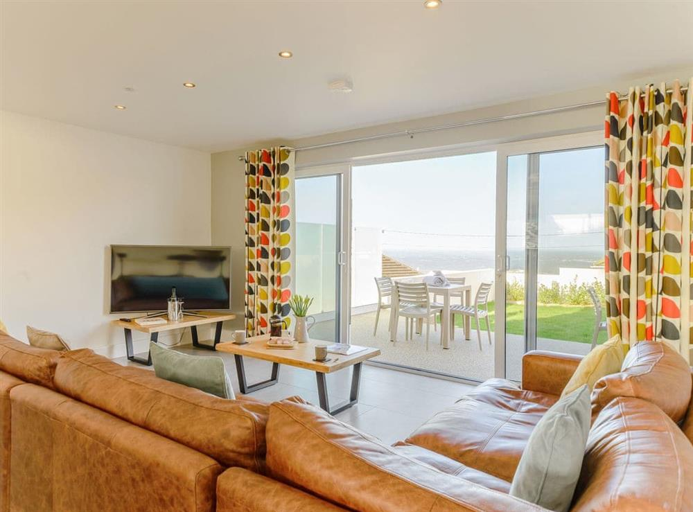 Light and airy living area with sea views at Ty Canol,