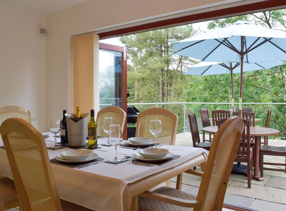 Dining area with bi-folding patio doors at Hafan Dawel in Stepaside, near Saundersfoot, Pembrokeshire, Dyfed