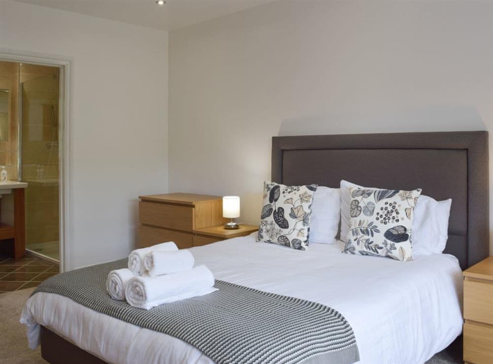 Master bedroom with en-suite at Hafan Dawel in Stepaside, near Saundersfoot, Pembrokeshire, Dyfed