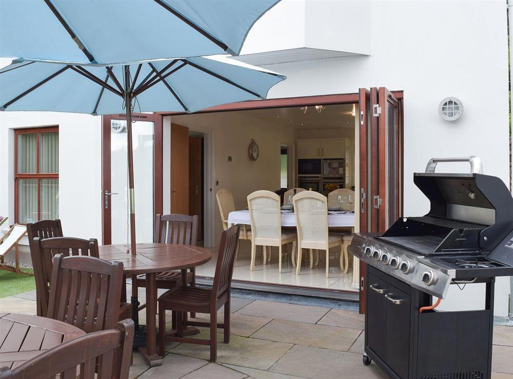 Outdoor dining area with BBQ at Hafan Dawel in Stepaside, near Saundersfoot, Pembrokeshire, Dyfed