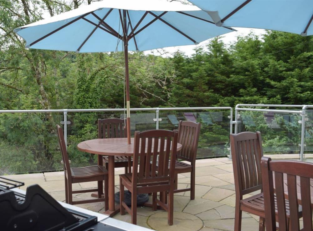 Outdoor dining area at Hafan Dawel in Stepaside, near Saundersfoot, Pembrokeshire, Dyfed