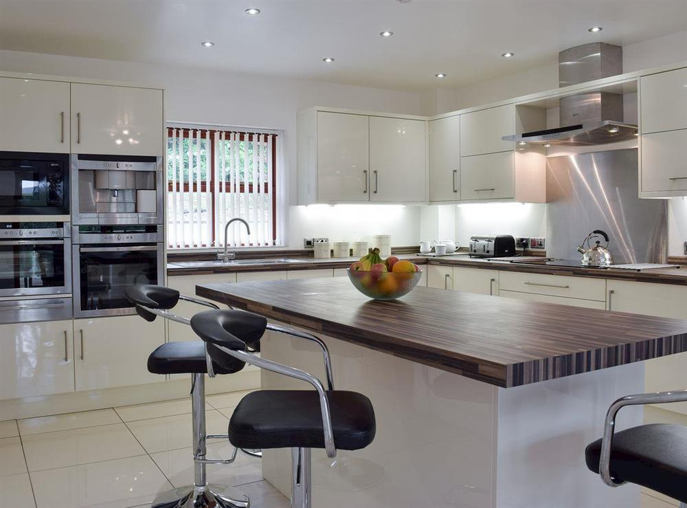 Well equipped kitchen with dining area at Hafan Dawel in Stepaside, near Saundersfoot, Pembrokeshire, Dyfed