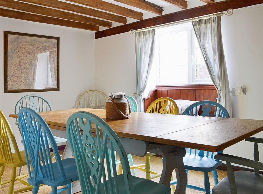 A shabby chic dining table comfortably seats up to eight guests at Half Penny Cottage in Docking, near Hunstanton, Norfolk