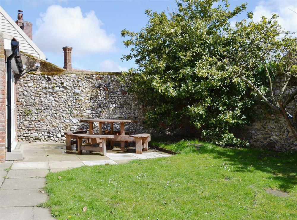 Sit out and enjoy the Norfolk sunshine in the enclosed private garden at Half Penny Cottage in Docking, near Hunstanton, Norfolk