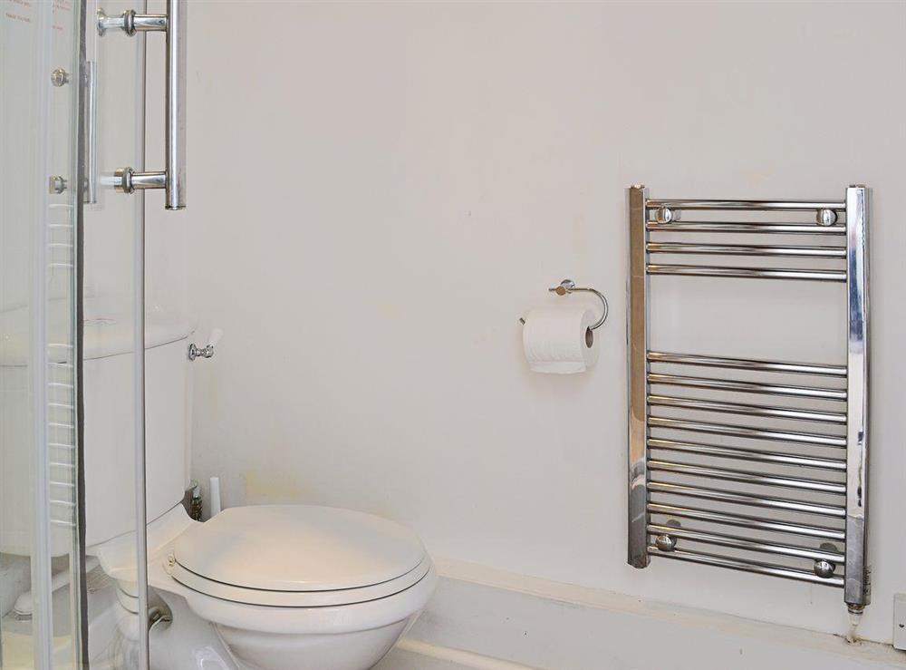 The en suite shower room has a heated towel rail at Half Penny Cottage in Docking, near Hunstanton, Norfolk