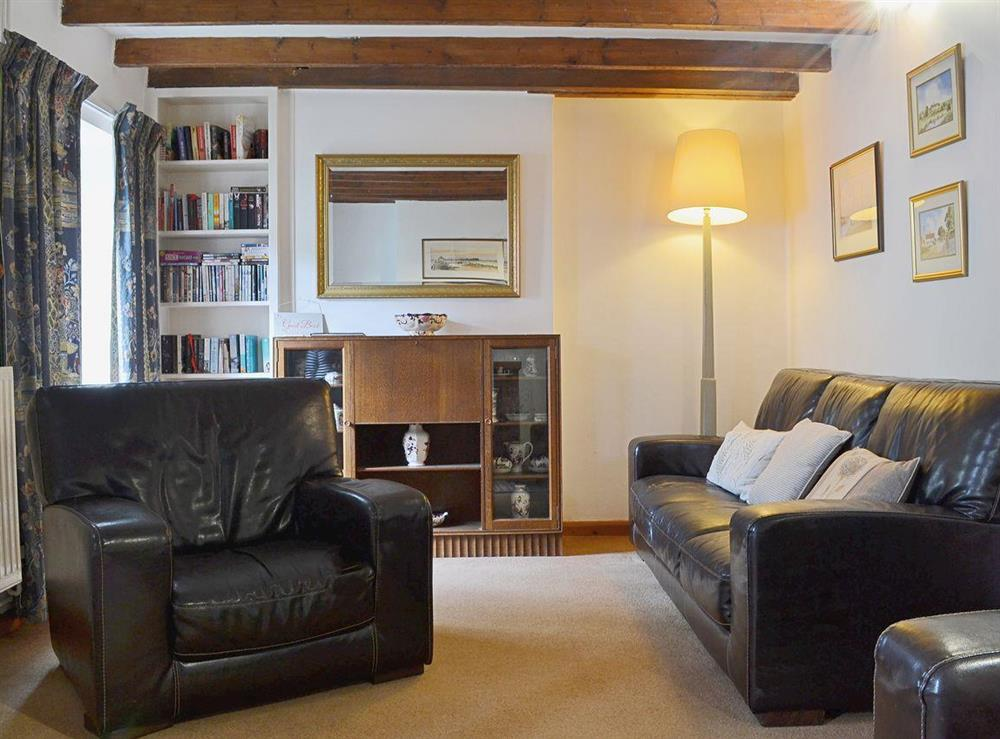 The living room has a leather suite for you to relax and unwind at Half Penny Cottage in Docking, near Hunstanton, Norfolk