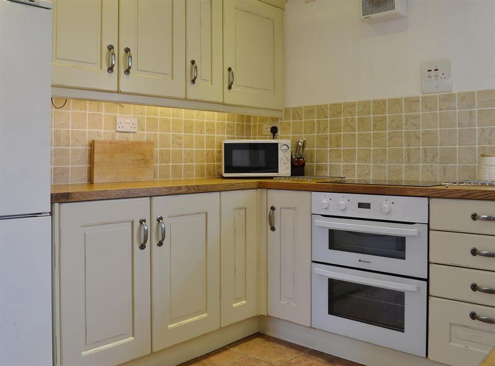 The lovely kitchen is half-tiled and equipped to a very high standard at Half Penny Cottage in Docking, near Hunstanton, Norfolk