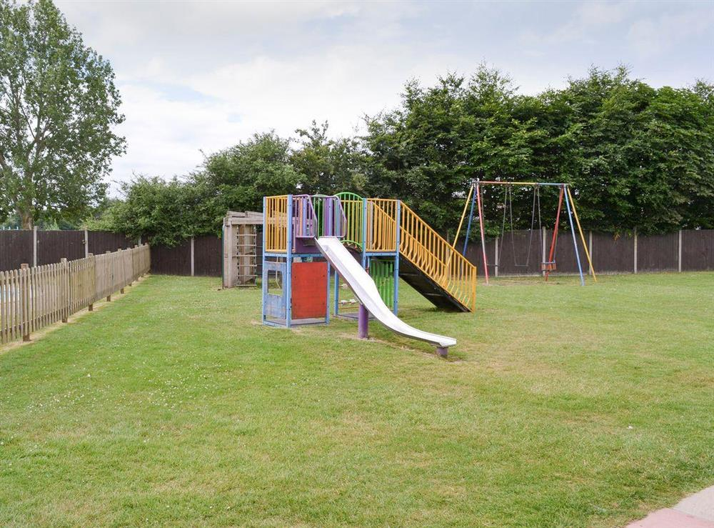 On-site children's outdoor recreation area at Happy Times in Stalham, Norfolk