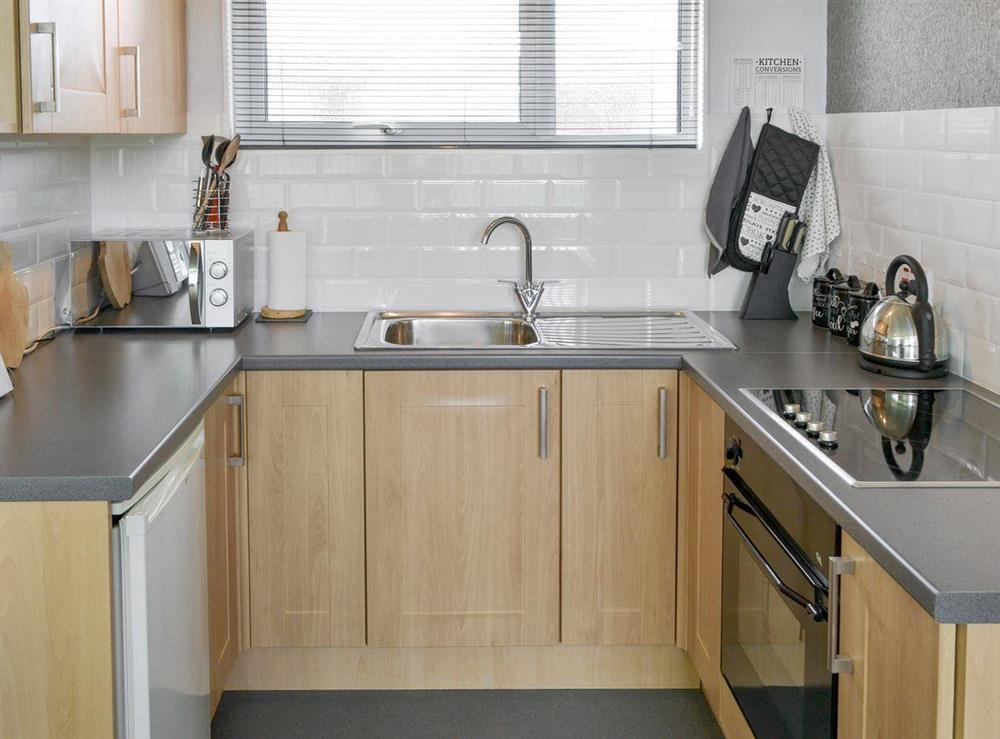 Well-equipped fitted kitchen at Happy Times in Stalham, Norfolk