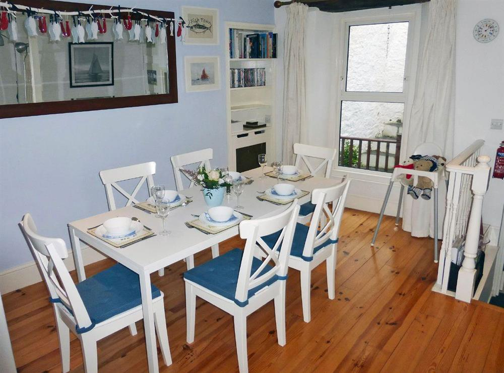 Inviting dining room at Harbour Watch in Brixham, Devon