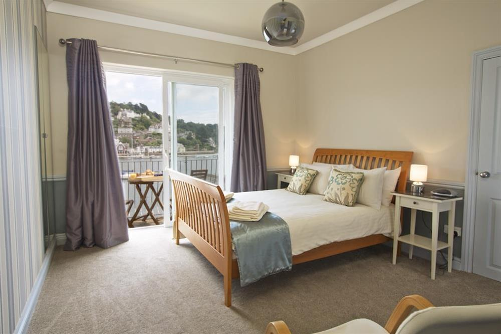 Master bedroom with a balcony and views towards Kingswear at Harbourside in South Town, Dartmouth