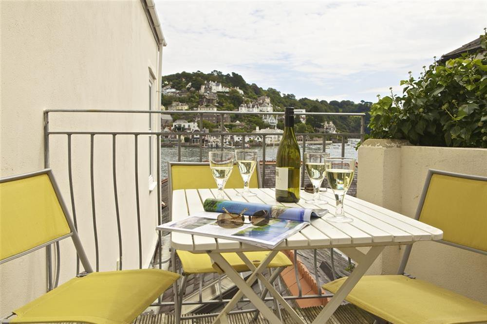 Sun terrace off  the kitchen with patio furniture and Southerly views at Harbourside in South Town, Dartmouth