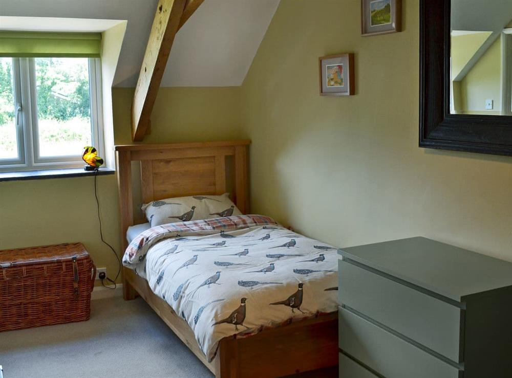 Charming twin bedroom (photo 2) at Harvest Cottage in Harbertonford, near Totnes, Devon