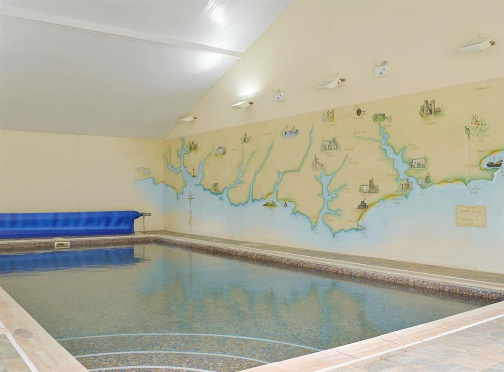 Large shared indoor swimming pool at Harvest Cottage in Harbertonford, near Totnes, Devon