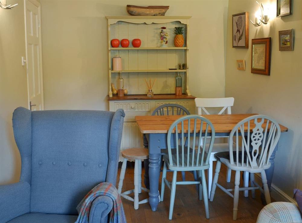 Warm and welcoming living/dining room (photo 2) at Harvest Cottage in Harbertonford, near Totnes, Devon