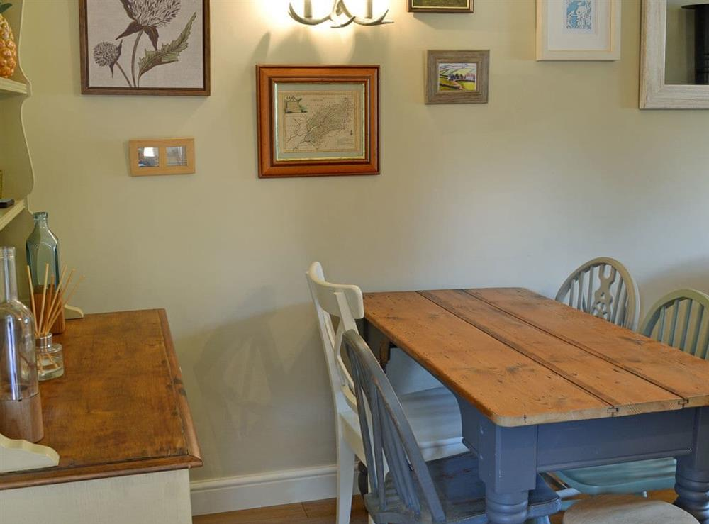 Warm and welcoming living/dining room (photo 3) at Harvest Cottage in Harbertonford, near Totnes, Devon