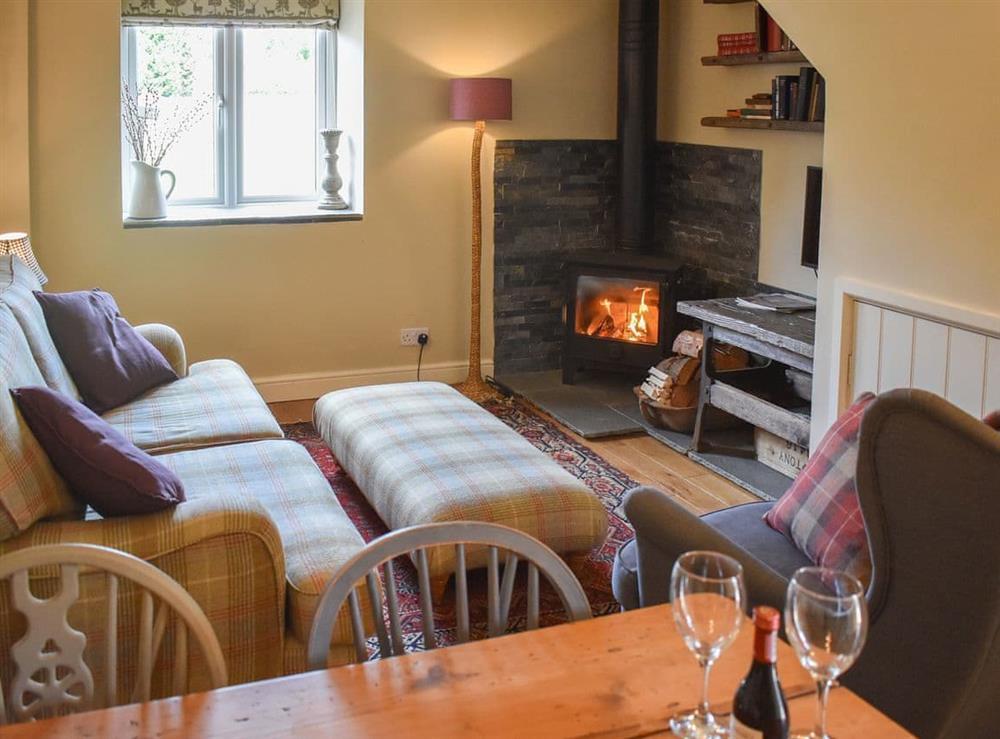 Warm and welcoming living/dining room at Harvest Cottage in Harbertonford, near Totnes, Devon