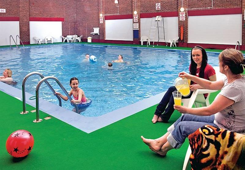 Indoor heated swimming pool at Hemsby Beach Holiday Village in Norfolk, East of England