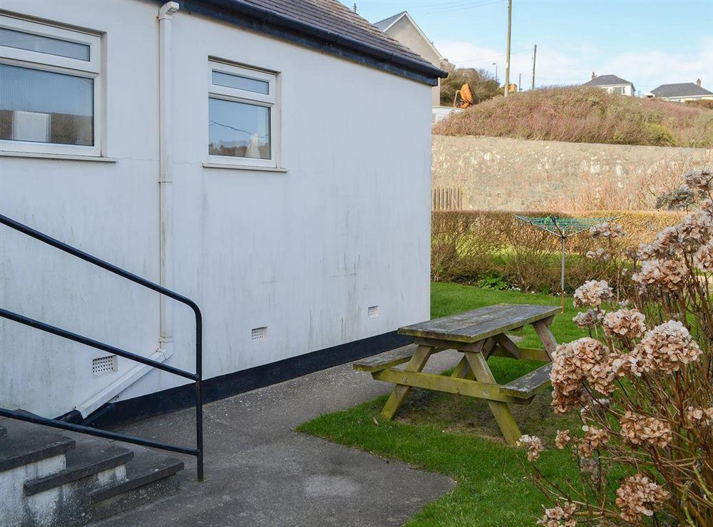 Modest garden with picnic style seating at Daron,
