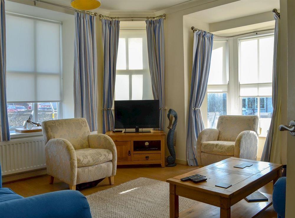 Stylishly furnished living room at Hywyn,