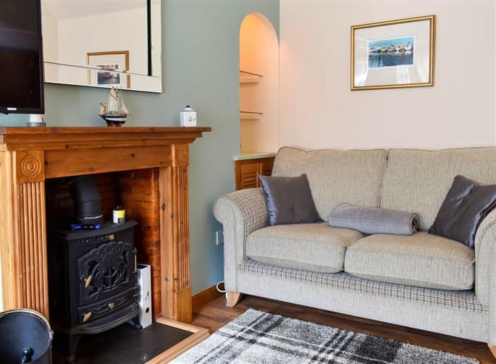 Cosy living area with wood burner at Heron Cottage in Lossiemouth, Moray, Morayshire