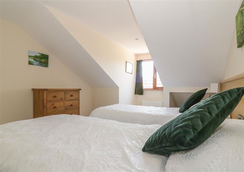 Bedroom at Heron Cottage, Wayford