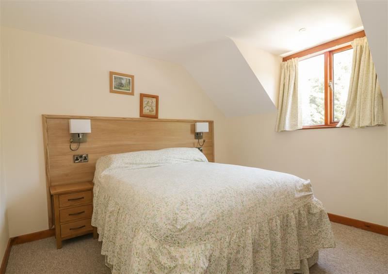 One of the 2 bedrooms at Heron Cottage, Wayford