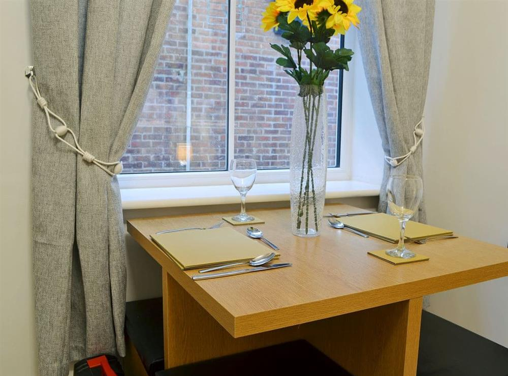 Charming dining area at Hidden Gem Cottage in Driffield, North Humberside