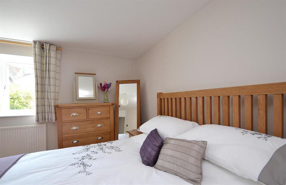 Comfortable beds with lovely linens at Hideaway, Harbertonford