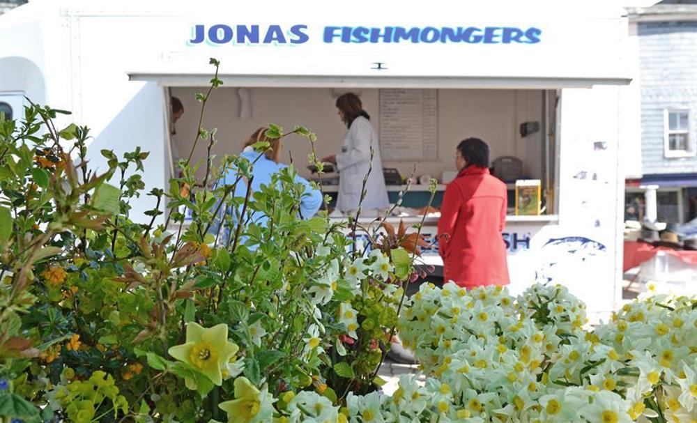 Flowers and a fish stall at Totnes market at Hideaway, Harbertonford