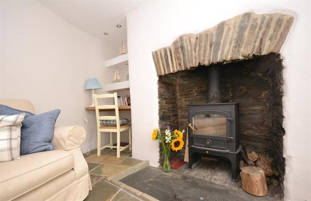 Snuggle up in front of the wood stove at Hideaway, Harbertonford