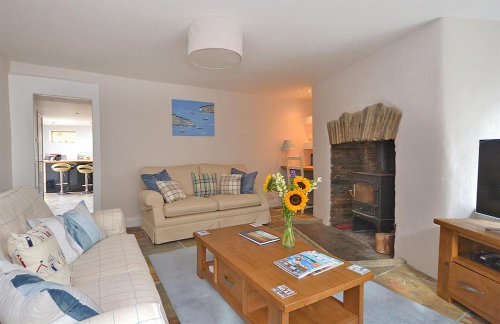 The comfortably appointed lounge with wood burner at Hideaway, Harbertonford