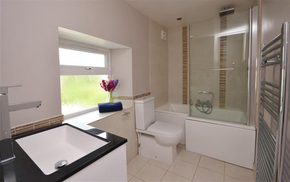 The modern family bathroom at Hideaway, Harbertonford