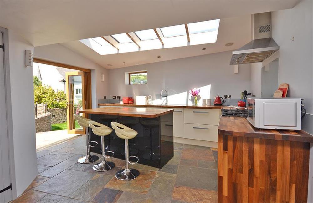 The superb kitchen with doors opening into the garden at Hideaway, Harbertonford