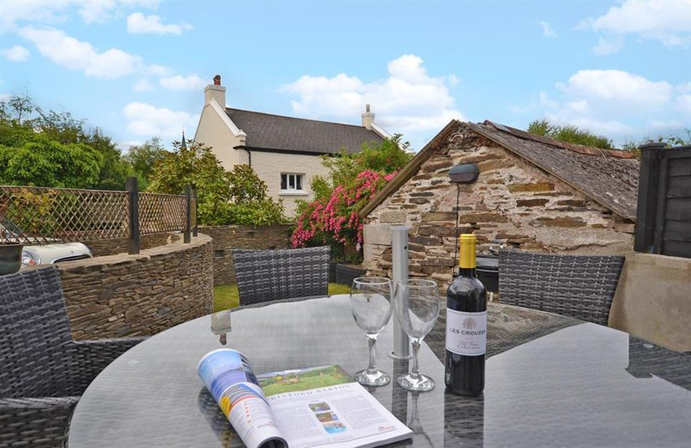 The terrace is furnished with lovely table and chairs at Hideaway, Harbertonford