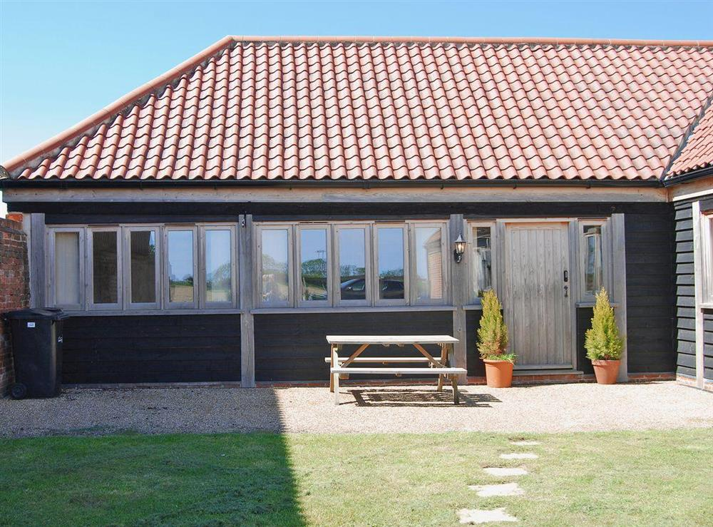 Stylish front elevation of holiday property at High Barn Canons in Langley, near Norwich, Norfolk