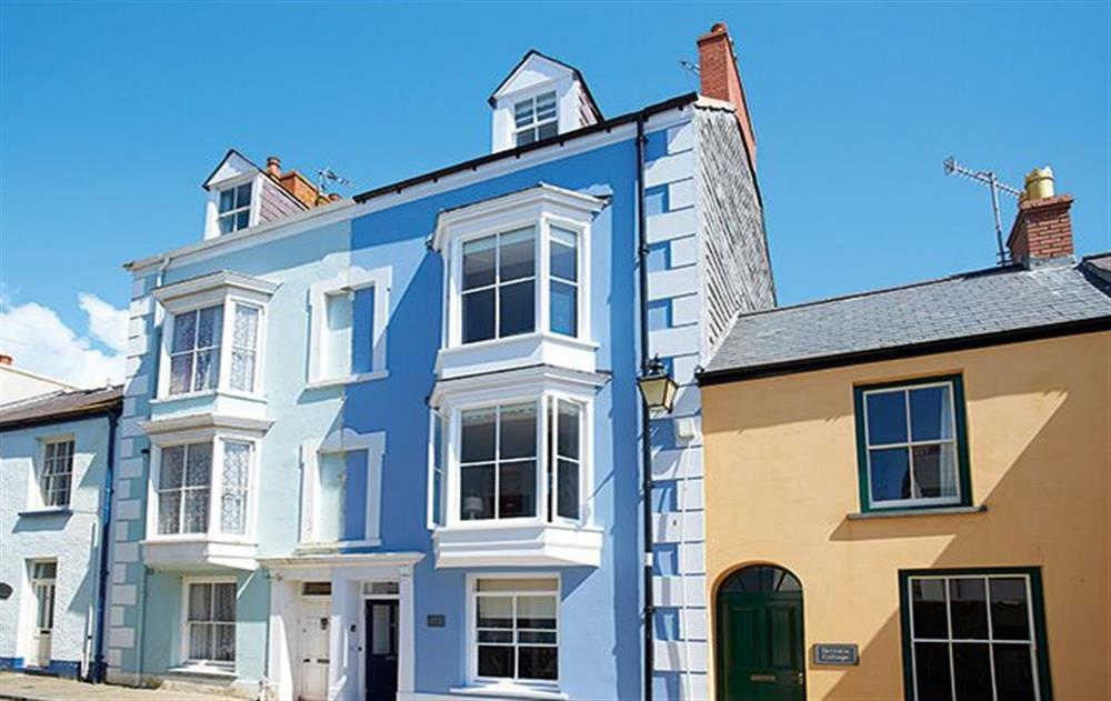 High House is the cornflower blue property with the dark front door at High House (Sleeping 10), Tenby